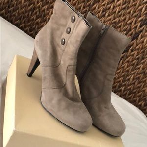 Taupe suede heeled booties.